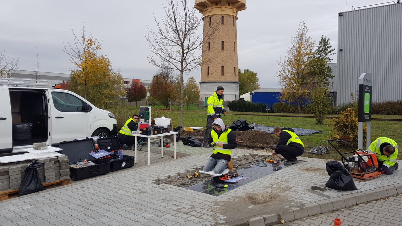Installing solar paving tiles at Prologis Park Budapest-Harbor, Hungary